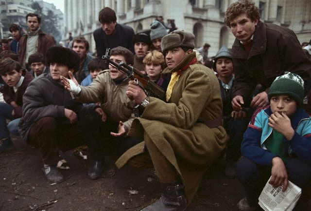 Students, soldiers and children participating in the Romanian Revolution. Image by © David Turnley/CORBIS